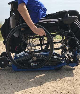 Location de chenillette pour fauteuil roulant manuel