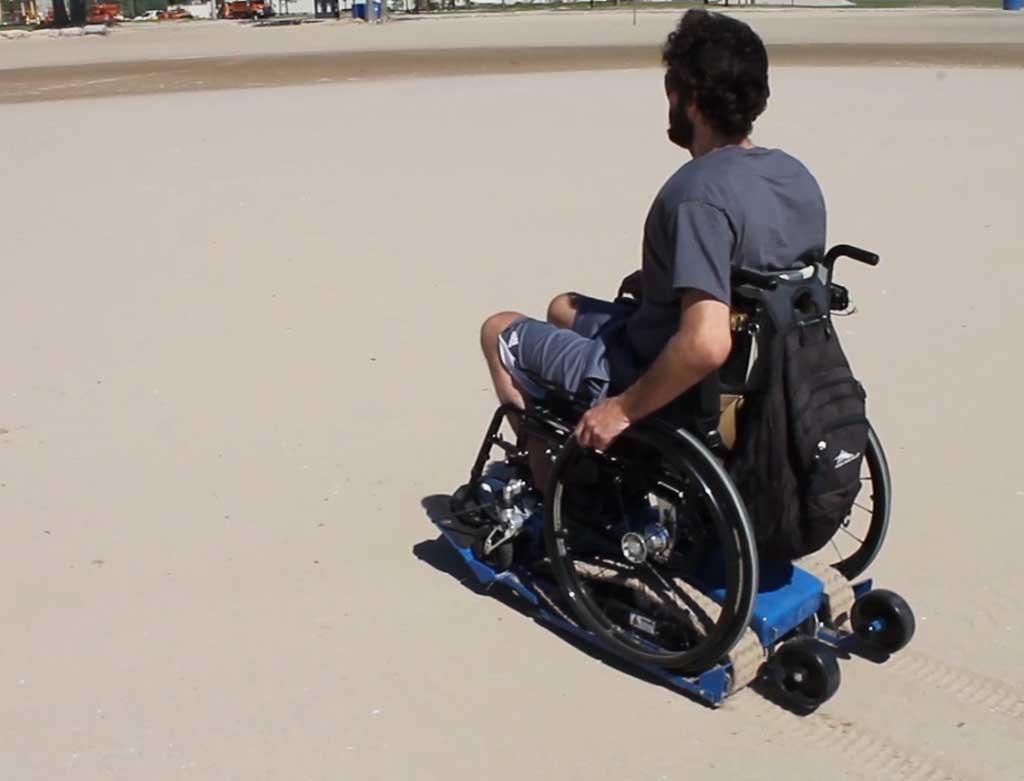 Location- de chenillette pour fauteuil roulant